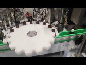малка машина за пълнене с течни бутилки
